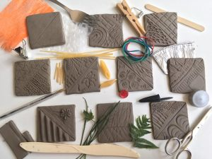 Test tiles made from air drying clay.