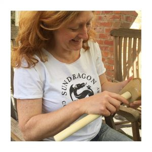 Kate is making sure that all of the wooden tools in the Sundragon box are nicely finished and have no splinters..